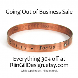"copper bracelet stamped ""clarity"" and ""focus"""