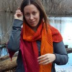 long triangular garter stitch shawl with lace edge and chevron detail, worked in alternating solid colors