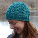 teal hat with multiple cables