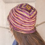 striped hat with rolled brim and square folded top
