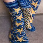 Inspired by Van Gogh's Starry Night painting, these starry socks are knit with two colors per row