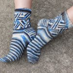 The leg portion of these socks is made of triangles that grow off of each other; a minimal amount of sewing is required
